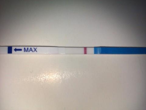 тест на беременность слабые полоски фото